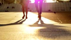 Two females walking together. women lifestyle. fashion. silhouette. feet foot Stock Footage