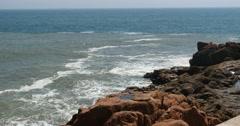 4k sparkling ocean sea water waves surface & coastal rock coast surge shore. - stock footage
