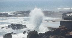 4k waves washed dam,People on shore.ocean sea water & coastal rock surge coast. - stock footage
