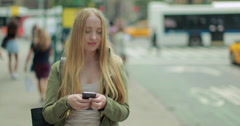 Young Caucasian blond woman texting smart phone cellphone in city - stock footage
