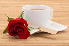Coffee and rose on table Stock Photos