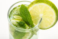 soft drink decorated with mint and lime - stock photo