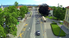 Ascending over city Vrhnika with bicyclist on road Stock Footage