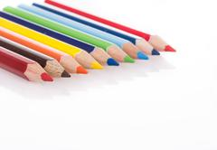 color pencils on white with reflection - stock photo