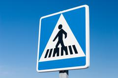 pedestrian road sign against blue sky - stock photo