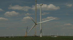 Wind turbine roter blades lifted 2 - stock footage