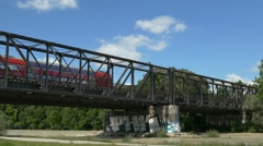 Double Deck Passenger Train passing metal Railway Isar river Munich Germany Stock Footage