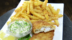 Fish with french fries (not loopable) Stock Footage