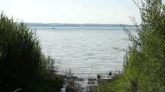 Stock Video Footage of Rails leading into lake Ammersee in bavaria, germany in summer
