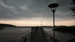 Wooden pier on big lake in Germany during a storm 2 Stock Footage