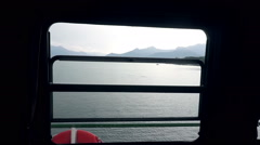 Ship window with seascape outside Stock Footage