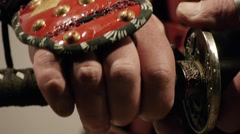 Samurai's hand, holding the handle of the sword Stock Footage