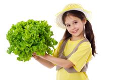 smiling girl with lettuce salad - stock photo