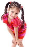 pretty girl standing with hands on knees - stock photo