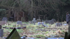 Pan of Two Teen Men Looking at Grave Stock Footage