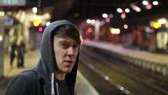 Teen waiting edge of Platform for Train Stock Footage