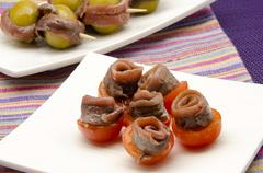 anchovies with tomato - stock photo