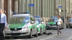 Green stripe German Police cars parking outside of Police Station Munich Germany Stock Footage
