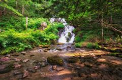 Waterfall in a creek Stock Photos