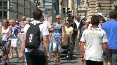 Downtown Crowds people Pedestrian Zebra Cross traffic Munich Germany Europe Stock Footage