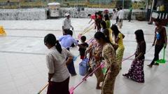 Burmese people cleaning floor of Shwedagon Pagoda located in Yangon, Burma Stock Footage