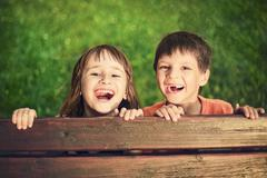 Outdoor portrait of smiling girl and boy Stock Photos