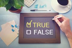True or false checkboxes sketched on a little blackboard Stock Photos