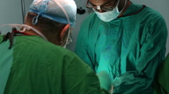 Doctor and assistant working in the operation room Stock Footage