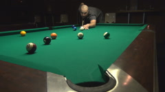 Handsome young man plays pool, great powerful shot ball in pocket, professional  Stock Footage
