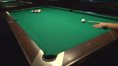 Cute man in bar, playing pool open table, great shot with wood cue, sport indoor Stock Footage