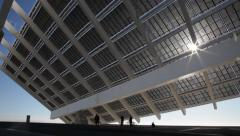 People under the large solar panel at barcelona city Stock Footage