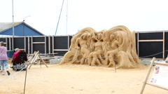 Sandsculpture with women spinning the threads of life Stock Footage