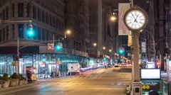 Famous Clock on 5th Ave in Manhattan, NYC - Beautiful Timelapse at Night 4K - stock footage
