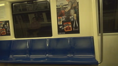 Inside subway train shot, train moving fast underground, no people on sits, move - stock footage