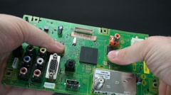 Breaking lcd tv circuit-board 2 Stock Footage