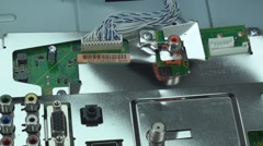Zoom out of broken lcd tv circuit-board 2 Stock Footage