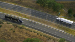 Aerial view of trucks on a highway Stock Footage