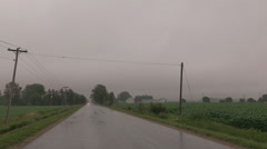 Heavy rain storm and wind pummel corn crop Stock Footage