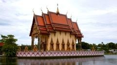 Buddhist Pagoda, Wat Plai Laem Temple on Water. Thailand. Stock Footage