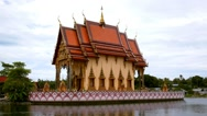 Stock Video Footage of Buddhist Pagoda, Wat Plai Laem Temple on Water. Thailand.