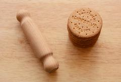 Rolling pin ready to crush biscuits Stock Photos