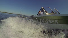 Splashes from a motor boat on both sides when riding on lake Stock Footage