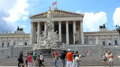 Tourists in front of Austrian parliament on beautiful sunny day, Vienna Stock Footage