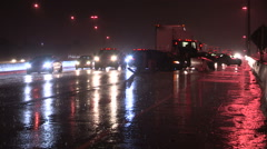 Car truck crash and accident scene on the highway in heavy rain storm at night. Stock Footage
