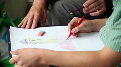 Drawing lesson outdoors, old teacher, student, teenage boy, hands, close up Stock Footage