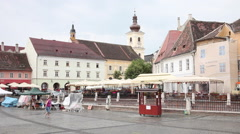 Medieval European old town, Romania, Central square, rainy day, church Stock Footage
