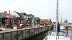 Walking on the quay in front of the restaurants in the harbor Stock Footage