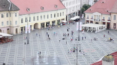People in central square,beautiful medieval town,Europe,architecture,aerial view Stock Footage
