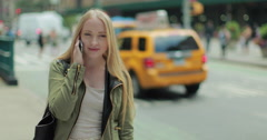 Young Caucasian blond woman talking on cellphone in city 4k Stock Footage