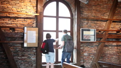Tourists in museum looking out the window, directions, town map, art exhibition Stock Footage